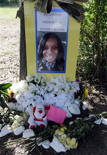 Flowers and other items adorn a memorial for Sandra Bland near Prairie View A&M University, Tuesday, July 21, 2015, in Prairie View, Texas.