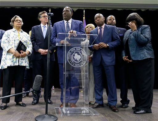 Texas Sen. Royce West, center, speaks next to Texas Lt. Gov. Dan Patrick, second from left, during a news conference, Tuesday, July 21, 2015, in Prairie View, Texas, following a meeting regarding the investigation into the death of Sandra Bland.