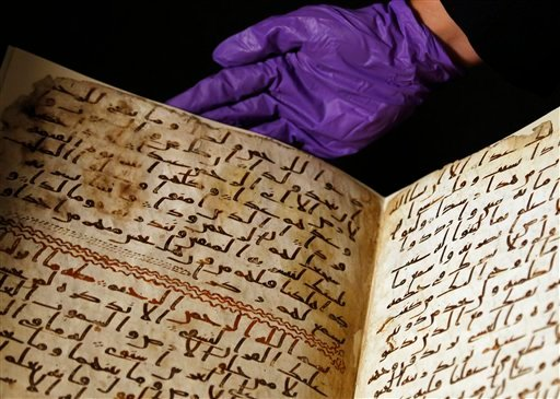 A university assistant shows fragments of an old Quran at the University in Birmingham, in Birmingham central England Wednesday, July 22, 2015. The University of Birmingham said Wednesday that scientific tests prove a Quran manuscript in its collection is