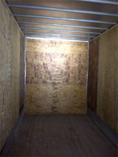This picture shows inside the trailer with the false wall that contained the wrapped packages of marijuana. Photo courtesy: U.S. Customs and Border Protection.