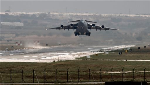 In this Sept. 1, 2013, file photo, a U.S. Air Force plane takes off from the Incirlik airbase, in southern Turkey. Turkey has agreed to let the U.S. military use the key air base near the border with Syria to launch airstrikes against the Islamic State, s