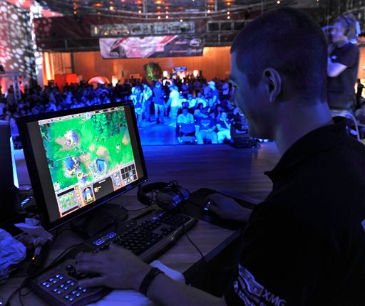 In this Aug. 7, 2009, file photo, a participant plays a computer game during the Intel Friday Night Game, a competition of the ESL, Electronic Sports League, in Dresden, Germany.