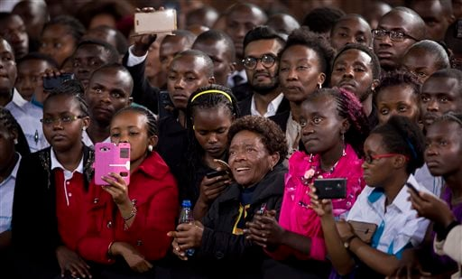 Members of the audience at the front of the crowd listen to President Barack Obama deliver a speech at the Safaricom Indoor Arena in the Kasarani area of Nairobi, Kenya Sunday, July 26, 2015. Obama is traveling on a two-nation African tour where he will b