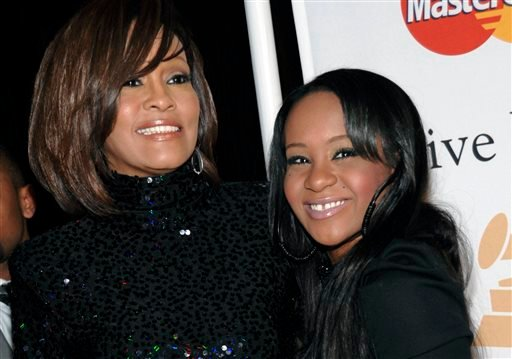 In this Feb. 12, 2011, file photo, singer Whitney Houston, left, and daughter Bobbi Kristina Brown arrive at an event in Beverly Hills, Calif. Brown, who was in hospice after months of receiving medical care, died on Sunday, July 26, 2015. (AP Photo/Dan