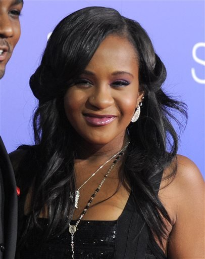 """In this Aug. 16, 2012, file photo, Bobbi Kristina Brown attends the Los Angeles premiere of """"Sparkle"""" at Grauman's Chinese Theatre in Los Angeles. The daughter of the late singer and entertainer Whitney Houston, who was in hospice care after months of re"""