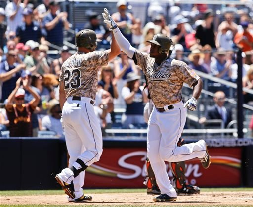 San Diego Padres' Justin Upton, right, is congratulated by teammate Yonder Alonso after his second inning home run against the Miami Marlins in a baseball game Sunday, July 26, 2015, in San Diego. (AP Photo/Don Boomer)