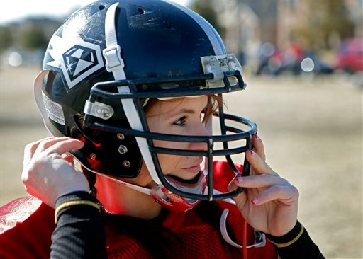 In this Feb. 12, 2014, photo, Jen Welter puts her helmet on before the start of the Texas Revolution practice at Bradford Crossing Park in Allen, Texas.