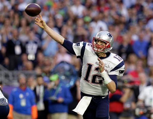 In this Feb. 1, 2015, file photo, New England Patriots quarterback Tom Brady (12) throws a pass during the first half of the NFL Super Bowl XLIX football game against the Seattle Seahawks in Glendale, Ariz. (AP Photo/Patrick Semansky)