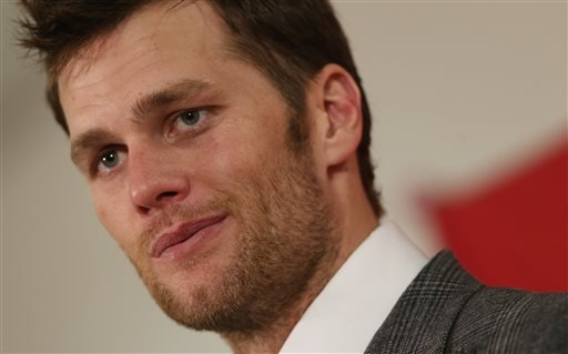 In this Jan. 19, 2014, file photo, New England Patriots quarterback Tom Brady reacts to question during news conference after his team's 26-16 loss to the Denver Broncos in the AFC Championship NFL football game in Denver. Brady's four-game suspension for