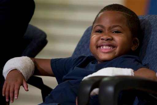 Double-hand transplant recipient eight-year-old Zion Harvey smiles during a news conference Tuesday, July 28, 2015, at The Children's Hospital of Philadelphia (CHOP) in Philadelphia. Surgeons said Harvey of Baltimore who lost his limbs to a serious infect