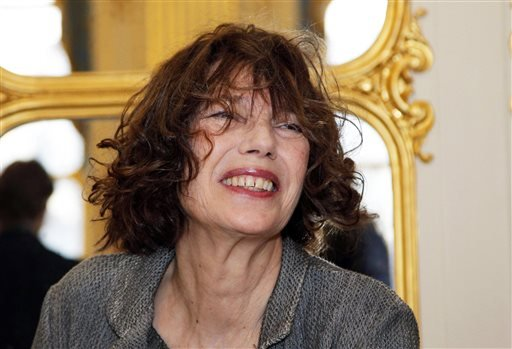 In this April 10, 2013, file photo, actress and singer Jane Birkin attends a ceremony as her daughter Lou Doillon was awarded Officer in the Arts and Letters by French culture minister Aurelie Filippetti, at the Culture Ministry in Paris.