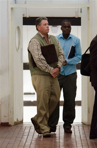 Professional hunter Theo Bronkhorst appears at Hwange magistrates' court to face poaching charges, about 435 miles (700 kilometers) west of the capital Harare, Wednesday, July, 29, 2015.