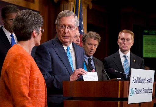 Senate Majority Leader Mitch McConnell, joined by, from left, Sen. John Thune, R-S.D., Sen. Joni Ernst, R-Iowa, Republican presidential candidate, Sen. Rand Paul, R-Ky., and Sen. James Lankford, R-Okla. (AP Photo/Manuel Balce Ceneta)