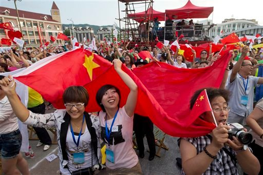 Residents celebrate after Beijing is announced as the host city for the 2022 Winter Olympics at the ski resort region of Chongli.