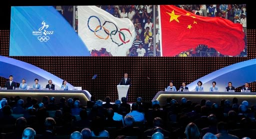 Chinese delegation attend the Beijing's bid presentation for the host city for the 2022 Winter Games, at the 128th International Olympic Committee session in Kuala Lumpur, Malaysia, Friday, July, 31, 2015.