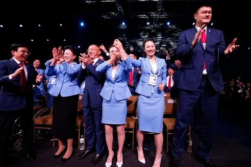 Members of the Beijing 2022 Winter Olympics delegation react after the city was elected to host the 2022 Olympic Winter Games at the IOC meeting in Kuala Lumpur, Malaysia, Friday, July 31, 2015.