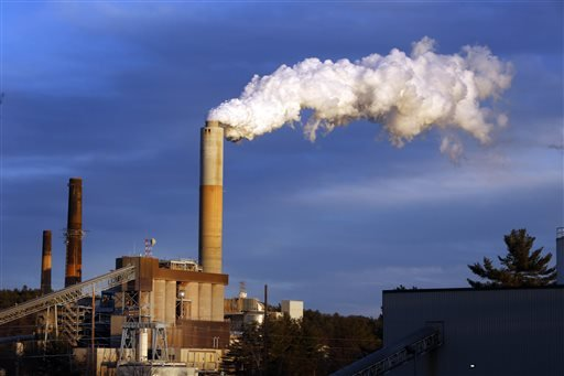 In this Jan. 20, 2015 file photo, a plume of steam billows from the coal-fired Merrimack Station in Bow, N.H. President Barack Obama on Monday, Aug. 3, 2015, will unveil the final version of his unprecedented regulations clamping down on carbon dioxide em
