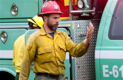 This 2014 photo provided by the Black Hills, S.D., National Forest shows U.S. Forest Service firefighter David Ruhl in the national forest near Custer, S.D. Ruhl, 38, of Rapid City, S.D., was killed while scouting a wildfire in Northern California when he