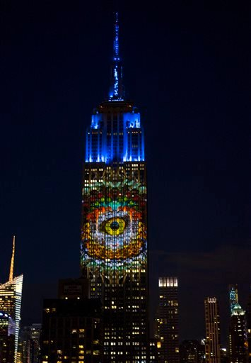 """Above photos show images of endangered species projected on south facade of The Empire State Building Aug. 1, 2015. The large scale projections are produced by the filmmakers of an upcoming documentary called """"Racing Extinction.""""(AP Photo/Craig Ruttle)"""