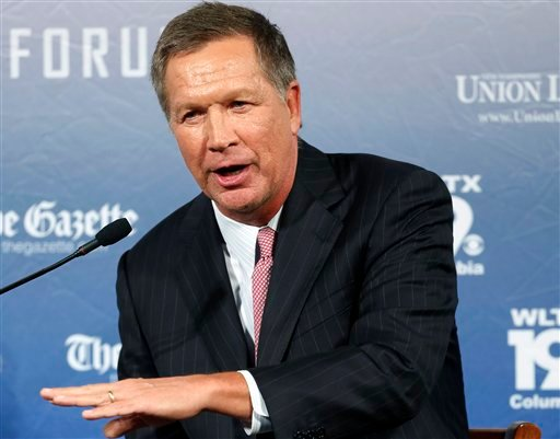 In this Aug. 3, 2015 file photo, Republican presidential candidate, Ohio Gov. John Kasich speaks in Manchester, N.H. Kasich's recent poll results earned him a place in the first prime time Republican presidential debate, Thursday.(AP Photo/Jim Cole, File)