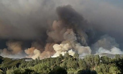 The fire has charred more than 60,000 acres and destroyed at least 24 residences. (AP Photo/Josh Edelson)