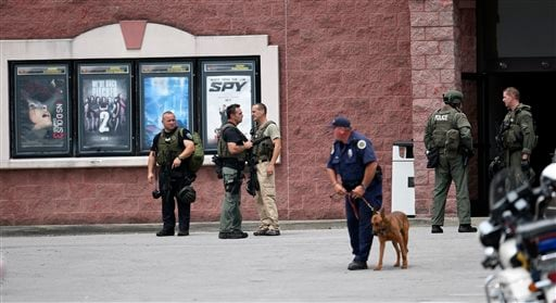 Metro Police respond to an active shooter call at the Carmike Hickory 8 theater, Wednesday Aug. 5, 2015, in Antioch, Tenn.