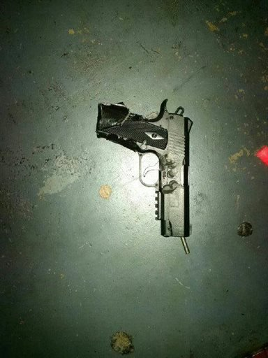 This photo released by the Metro Nashville Police Department shows a pellet gun carried by an attacker at a movie theater in Antioch, Tenn., Wednesday, Aug. 5, 2015. A man armed with a hatchet and a pellet gun unleashed a volley of pepper spray at audienc