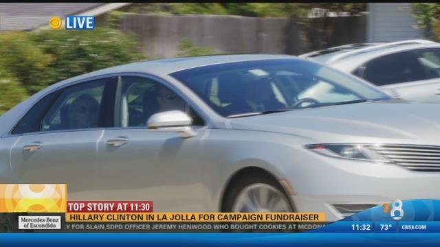 Hillary Clinton waving goodbye from a silver car, as she leaves La Jolla after her breakfast fundraiser, Friday, August 7, 2015.