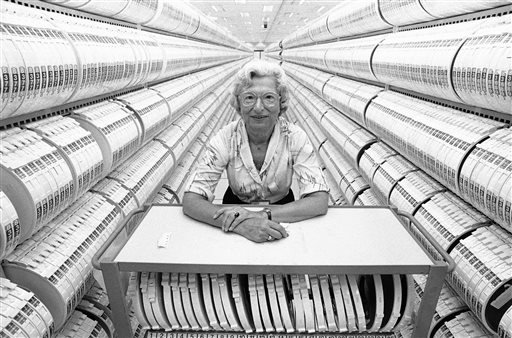 Aug. 12, 1985, file photo: Lillie Steinhorn, 74, stands inside the computer tape storage room at the headquarters of the Social Security Administration in Baltimore. (AP Photo/Bill Smith, File)