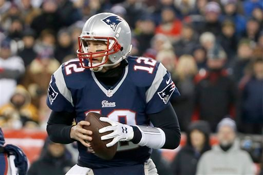 Jan. 10, 2015, file photo: New England Patriots quarterback Tom Brady (12) rolls out to pass against the Baltimore Ravens in the first half of an NFL divisional playoff football game in Foxborough, Mass. (AP Photo/Elise Amendola)
