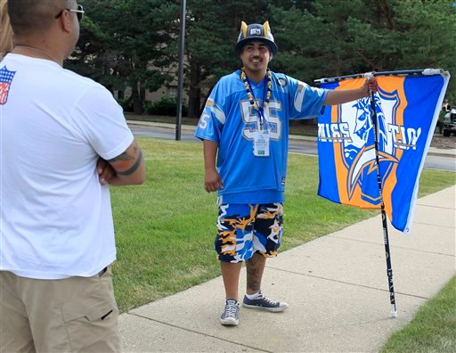San Diego Chargers' fan Johnny Abundez protests outside of the NFL Owners Meeting at the Hyatt Regency hotel, Tuesday, Aug. 11, 2015, in Schaumburg, Ill.