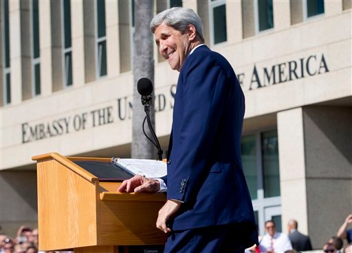 Secretary of State John Kerry smiles while delivering his remarks during the flag raising ceremonies at the newly reopened embassy in Havana, Cuba. Aug. 14, 2015. (AP Photo/Pablo Martinez Monsivais, Pool)