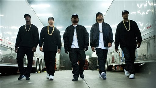 """This photo provided by Universal Pictures shows, Aldis Hodge, from left, as MC Ren, Neil Brown, Jr. as DJ Yella, Jason Mitchell as Eazy-E, O'Shea Jackson, Jr. as Ice Cube and Corey Hawkins as Dr. Dre, in the film, """"Straight Outta Compton."""" The movie relea"""