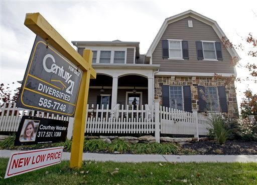 This Oct. 20, 2009, file photo, shows a home with a reduced price for sale in Carmel, Ind., neighborhood.