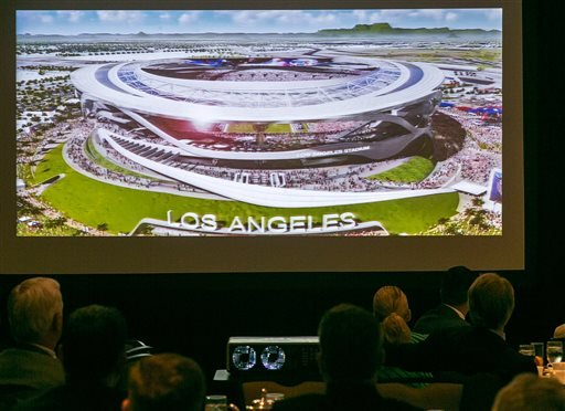 An architectural rendering for a new NFL stadium is projected during a lunch sponsored by the Los Angeles Sports Council downtown Los Angeles Monday, Aug. 17, 2015. The $1.7-billion new NFL football stadium proposed for Carson by the owners of the San Die