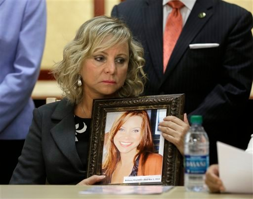 Debbie Ziegler holds a photo of her daughter, Brittany Maynard, the California woman with brain cancer who moved to Oregon to legally end her life last fall, during a news conference to announce the reintroduction of right to die legislation, Tuesday, Aug