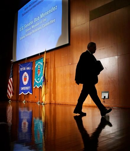 Sen. Bob Menendez walks off stage after addressing a gathering at Seton Hall University, Tuesday, Aug. 18, 2015, in South Orange, N.J. Menendez announced on Tuesday his opposition to the Iran nuclear deal, the second Democratic senator to go against Presi