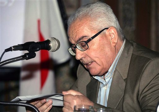 In this undated photo released Tuesday, Aug. 18, 2015 by the Syrian official news agency SANA, one of Syria's most prominent antiquities scholars, Khaled al-Asaad, speaks in Syria. Islamic State militants beheaded al-Asaad in the ancient town of Palmyra,