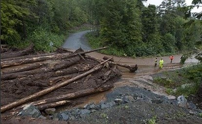Homes in the town have been flooded, and there were reports of residents not being able to reach their homes or leave their neighborhood, said a spokesman for the state Department of Homeland Security and Emergency Management. AP
