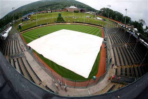 Rain falls on the covered field at Lamade Stadium Thursday, Aug. 20, 2015, in South Williamsport, Pa.
