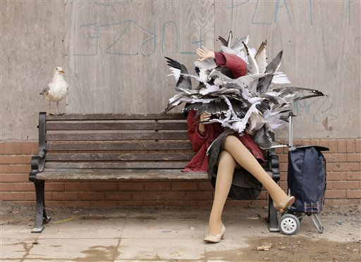 A Banksy piece depicting a woman attacked by seagulls is displayed at Banksy's biggest show to date, entitled 'Dismaland', during a press viewing in Western-super-Mare, Somerset, England.