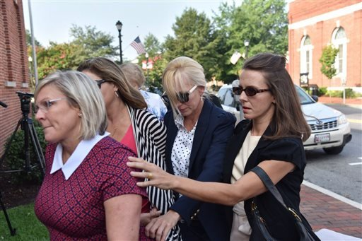 Molly Shattuck, second from left, leaves the Sussex County Courthouse in Georgetown, Del., Friday, Aug. 21, 2015.