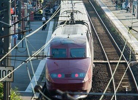 A Thalys train of French national railway operator, SNCF, stands at the main train station in Arras, northern France, after a gunman opened fire injuring three people. AP