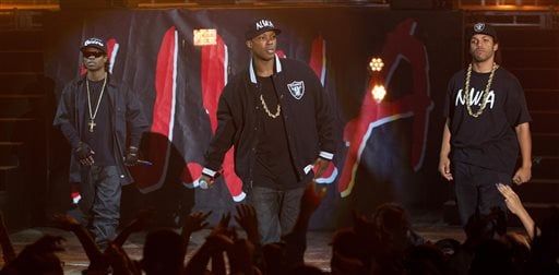 """This photo provided by Universal Pictures shows, Jason Mitchell, from left, as Eazy-E, Corey Hawkins as Dr. Dre, and OíShea Jackson, Jr. as Ice Cube, in the film, ìStraight Outta Compton."""" (Jaimie Trueblood/Universal Pictures via AP)"""