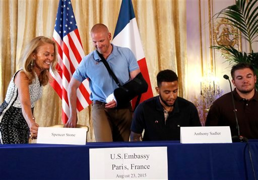 Anthony Sadler, a senior at Sacramento University in California, second right, U.S. National Guardsman from Roseburg, Oregon, Alek Skarlatos, right, U.S. Airman Spencer Stone, second from left, and U.S. Ambassador to France Jane D. Hartley take their seat