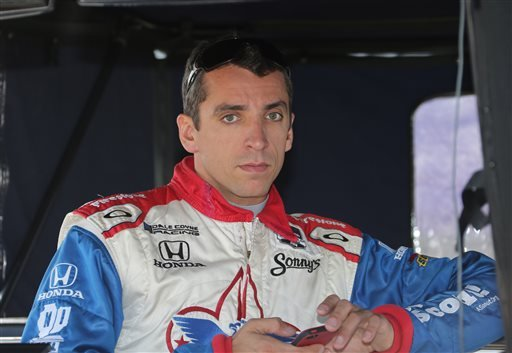 This is a June 1, 2014, file photo showing Justin Wilson waiting to qualify before the second race of the IndyCar Detroit Grand Prix auto racing doubleheader in Detroit. The IndyCar Series has bounced from one problem to another all season as it scrambles