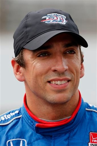 This file photo of May 16, 2015, shows Justin Wilson, of England, posing for a photo after he qualified for the Indianapolis 500 auto race at Indianapolis Motor Speedway in Indianapolis. Wilson has died from a head injury suffered when a piece of debris s