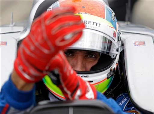 This is a May 14, 2015, file photo showing Justin Wilson, of England, putting on his gloves as he prepares to drive during practice for the Indianapolis 500 auto race at Indianapolis Motor Speedway in Indianapolis. The British driver was in a coma in crit