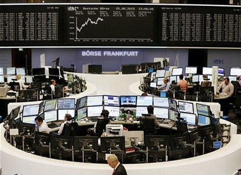 The German stock index DAX is displayed on a board when the DAX went up close to 10,000 points again at the stock market in Frankfurt, Germany, Tuesday, Aug. 25, 2015. (AP Photo/Michael Probst)