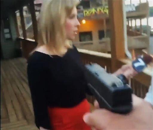 In this framegrab from video posted on Bryce Williams' Twitter account and Facebook page, Williams, whose real name is Vester Lee Flanagan II, aims a gun at television reporter Alison Parker as she conducts a live on-air interview.